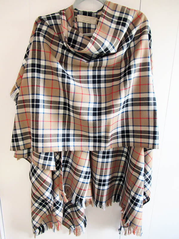 A more casual Stole featuring a brown red and black Tartan.