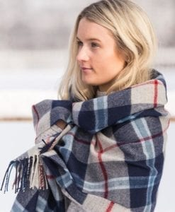 A beautiful demonstration of how to properly wear a traditional Tartan stole for sale.