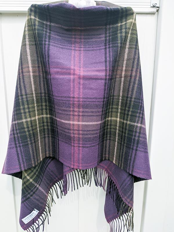 A beautiful purple Poncho with a plaid Tartan.